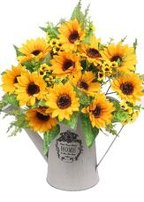 Tin watering can vase with sunflower bouquet