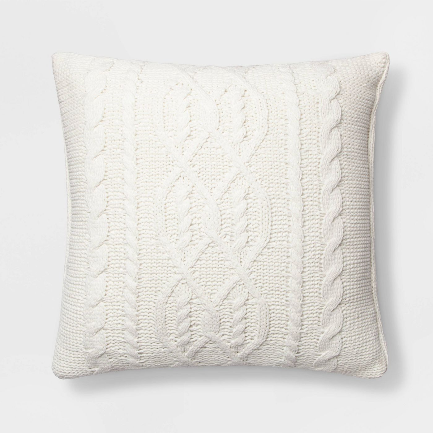 Cream knitted throw pillow