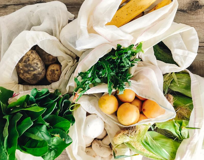 reusable bags full of fresh produce