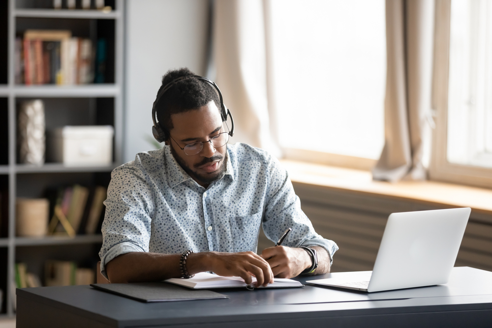 Focused man working from his home office