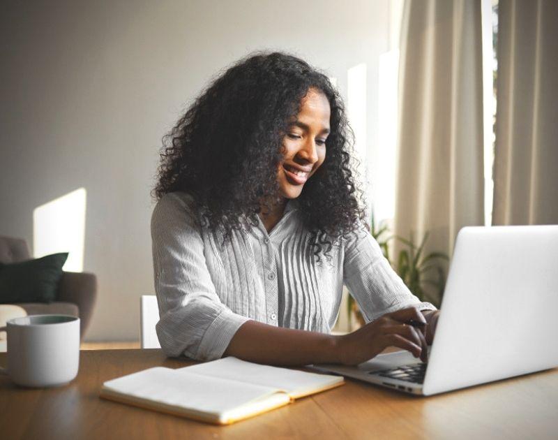 woman smiling at computer