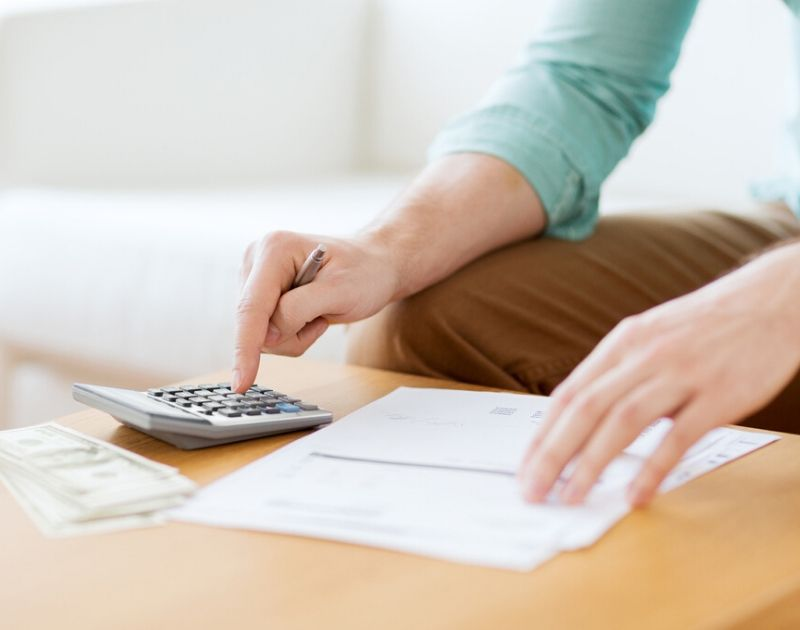 Man figuring out his budget for financial emergencies