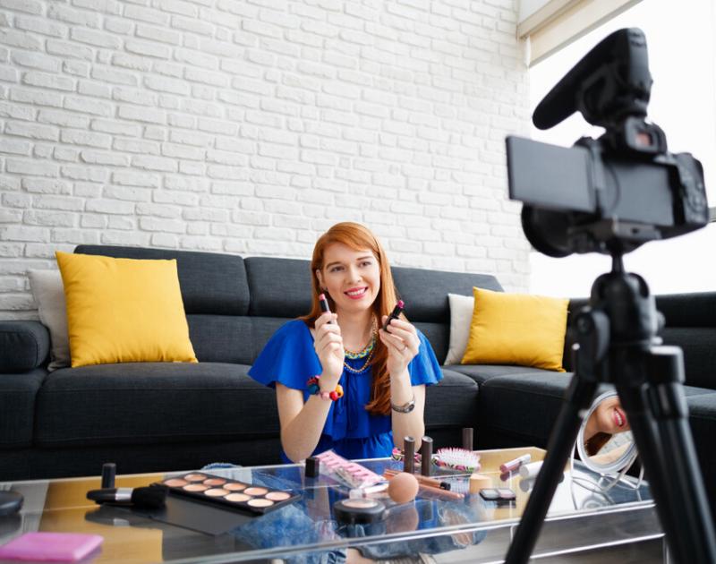 Young woman vlogging her new makeup for her brand ambassador job